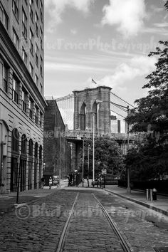 Neighborhood. Black and White Photograph Brooklyn Bridge Photograph. Art Photography. Sizes Available from 5x7 to 20x30. A great neighborhood shot of the Brooklyn bridge with cobblestone streets with tracks running through them. The street leads to a waterside park with views of Manhattan. It is also home to a glass encased Ferris Wheel. ***Photo comes un-matted and un-framed. Photos are shown in a room setting and are for size comparison. Last photo is a size comparison chart, is not the...