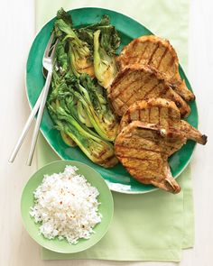 Soy sauce, ginger, and honey make an irresistible glaze for pork rib chops. Serve with lightly charred bok choy and rice seasoned with vinegar and red-pepper flakes.