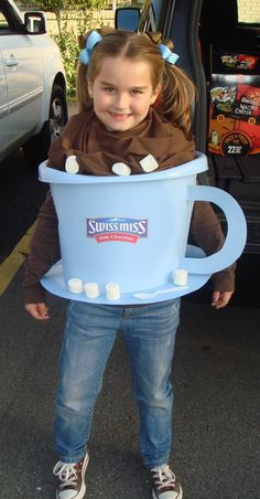 Hot cocoa costume - I found this idea on a website for homemade costumes.  The cup is a laundry basket and I made the Swiss Miss sticker on my computer.  Looks simple...but it wasn't!  LOL
