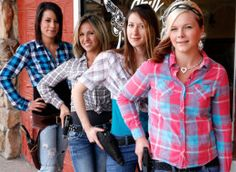 Waitresses with their sidearms in front of the Shooters Grill in Rifle, Colo., June 23, 2014.