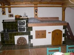 Stove with sleeping area on top Wood Stove Cooking, Wood Fired Oven, Rocket Stoves, Natural Building, Old Kitchen, Design Case, Modern Design, House Plans, Sweet Home