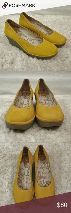 Fy London Yoni Yellow Suede Wedges Size 10 (40) In great condition and only worn a few times. They have minor scuffs throughout from other shoes laying on top of them in my closet. They are listed as a size 40 and that would be a size 10 in U.S. sizing. Made of suede leather with a 2.5 inch heel. Add to a bundle to receive 20% off. Offers welcomed. Fly London Shoes Wedges