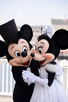 Mickey Mouse and Minnie Mouse in their Disney wedding attire