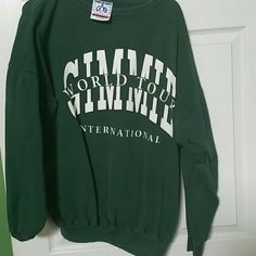 SWEATSHIRT BEING DONATED AFTER TODAY Green sweatshirt excellent condition  GIMMIE international is a golf tour per google. I just liked the color of green when I bought this one G.A.B Tops Sweatshirts & Hoodies