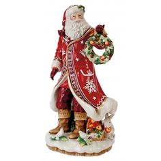 The Winter Garden Santa Figurine is robed in bright red complemented with antique white details. This elegant ceramic Santa stands proudly holding a holiday wreath, surrounded by his forest friends and a basket of fruit. The details and quality of this piece make it one of the most luxurious Fitz and Floyd Santa Figurines to date!
