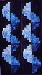 Spiraling Log Cabins quilt. I like the different shades of blue.