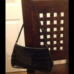 """Michael Rome by Besozzi Black Leather Purse 12"""" x 1"""" x 7"""".  Strap is approx 26"""".  Pre owned black purse but barely used.  The white spots on the inside are dust.  Has some creases in the back. Michael Rome Bags"""