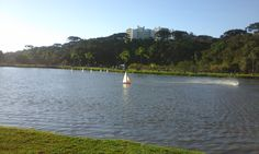 Remote control boats on the lake in Bacacheri Park, Curitiba