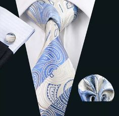"""This is a brand new silk tie set. Set includes coordinating tie, handkerchief and cuff links. Available in various patterns.    **Please Note** This item requires three (3) weeks to ship.  Please take the shipping time into consideration prior to placing your order. Thank you ~    **International Shipping Is Available For This Item For $6.80.     Also available on our website @ www.UyleesBoutique.com in our """"Men's Ties"""" section. 