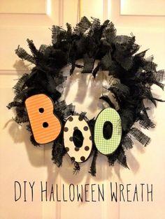 DIY Halloween Wreath. Super easy, super cute, and super cheap!! #halloween #DIY #wreath