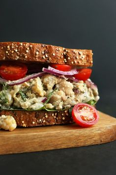 A simple 30-minute meatless sandwich made with tender chickpeas, crunchy roasted sunflower seeds, and a dairy-free dressing. Top with a garlic-dill sauce for healthy lunch bliss.