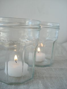 Bonne Maman jam jars as candle holders for reception tables