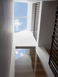 Inside, a void that runs from the roof to the ground floor is topped with a large roof light