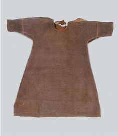 11th c CE Coptic tunic, wool with complimentary colored stitching. Neckline finished with linen band. Christie's Sale 9723 lot 273, detail. Sayyeda al-Kaslaania's Fatimid Arts: September 2011