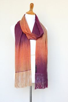 Woven wrap in fuchsia, orange and beige colors. Color changing gradually lengthwise. This long scarf is perfect gift for her! Also this #pashmina scarf is very soft and comf... #kgthreads