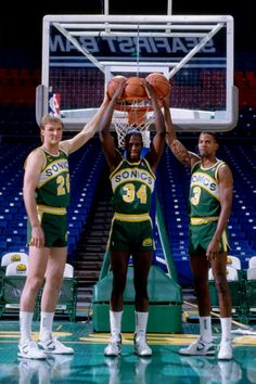 Tom Chambers Xavier McDaniel and Dale Ellis of the Seattle Supersonics poses for a portrait circa 1989 at the Seattle Coliseum in Seattle Washington...