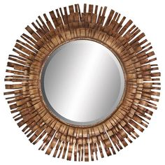 Starburst wall mirror with a metal strip frame.Product: Wall mirrorConstruction Material: Mirrored glass and metal