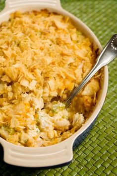 Hot Chicken Salad Recipe 2 T fresh lemon juice 1/2 t pepper  1/2 t salt  1/2 cup slivered almonds  1 cup diced celery  2 cup cooked chicken breast, cubed  1 cup mayonnaise  1 cup grated sharp cheddar cheese  2/3 cup crushed potato chips  Combine all except chips. Place the mixture in a greased 9x13 dish.  Spread the crushed potato chips on top.  Bake at 350 for 20 minutes, or until bubbly.