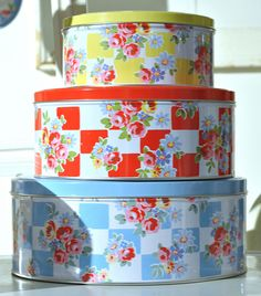 Cath Kidston cake tins. Very cottage friendly designer.