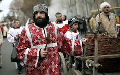 Participants march through the streets of Tblisi, Georgia, during the Alilo religious procession