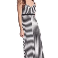 """Mitered Striped Maxi Dress Long A-line silhouette patterned with converging stripes in our timeless tones. Crafted from soft knit jersey with an elegant drape. 95% Polyester, 5% Spandex. Machine wash, cold. Imported.  Stretch fit. V-neck and back. Solid empire waist. Double layered bodice; unlined skirt. Length: 56"""". In good condition. Worn gently. White House Black Market Dresses Maxi"""