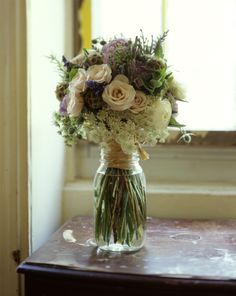 Bridal Bouquet by @Rebecca Parker Brooklyn for Wedding at Brooklyn Society for Ethical Culture in June featuring raununculus, lisianthus, queen anne's lace, thistles, sage, salvia, lavender, mint, scabiosa pods, rosemary