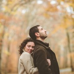 This engagement session makes the absolute most of fall's beauty. A forest of yellow and old train tracks!
