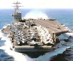 A Nimitz class aircraft carrier carrying a full complement of aircraft