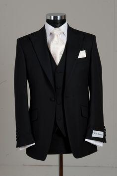 Nicks suit - minus the vest. Black suit ivory tie!