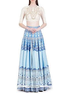 This delightful diva accoutre features unique styling and unusual material. All of this accenting the feminine beauty, with this blue and white tafeta silk designer lehenga choli. The digital print wo...