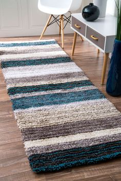 The Rugs USA Keno Striped Shaggy Rug offers cushiony comfort and casual quality all wrapped into one. The plush, soft rug features stripes of complementing colors that run width-wise across the rug. The color ribbons are varying widths, adding dimension to the look of the rug. The rug features a shaggy pile which contributes to an incredibly soft feeling underfoot, while also giving it a casual, comfortable look and impression. The rug is not overbearing but its use of colors will help to…