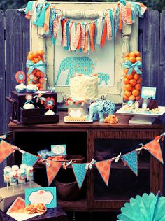 love the use of all the ribbon and the pendant banner...and the baby elephant theme is cute too #party