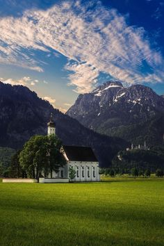 The St. Coloman Church stands prominently against the Alps in Bavaria, Germany. | Blog by the Planet D | #Travel #TravelPhotography #Wanderlust #TravelInspiration #Bavaria #Germany Amazing Photography, Travel Photography, Sunflower Pictures, Permanent Vacation, Visit Germany, Church Building, Canoe Trip, Greatest Adventure, The St