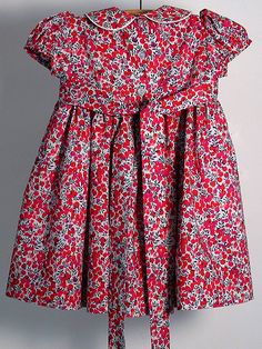 A classic, traditional dress for special occasions or just every day! NB. This is custom made using our own original and copyrighted pattern, exclusive to ourselves. Description:- It is made from Liberty Tana Lawn fabric, in their classic Wiltshire Berries design Tana Lawn