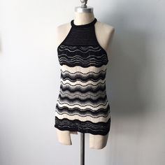 M Missoni black & white racerback tank Gorgeous M Missoni sweater tank in like new condition. Black and white classic Missoni zig zag knit.  Cut-in armhole neckline for a super sexy cut. Top portion of the bodice near the neckline is semi-sheer. Thin straps, racerback. Stretches. Fabric content is not listed, care is dry clean only. Italian size 38, approximate US size XS, fits a 0/2 best. M by Missoni Tops Tank Tops