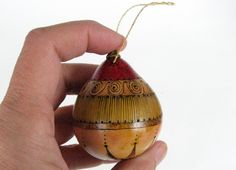 Red Swirl Gourd Ornament with Pyrographic Design. $25.00, via Etsy.