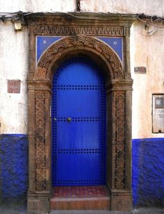 Blue door like this with nail heads.
