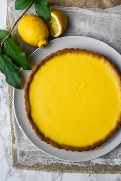 A crisp buttery crust with a smooth tangy lemon custard. That is all you need to recreate this utterly iconic French dessert: a Classic French Lemon Tart. A must to have in your baking repertoire a… French Lemon Tart Recipe, French Tart, Lemon Tart Recipe Martha Stewart, Lemon Fruit Tart Recipe, Lemon Tarte Recipe, Lemon Custard Tart, Lemon Curd Dessert, Citrus Tart, Tart Recipes