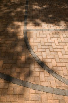 Paver stones marking basketball court in driveway