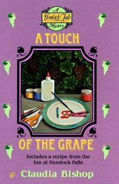 A Touch of the Grape (1998) (The sixth book in the Hemlock Falls series) A novel by Claudia Bishop