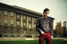 Brown shirt with a waded and quilted front side, highlighted with buttons combined with red trouser.
