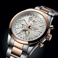 Longines conquest classic moon face 18k