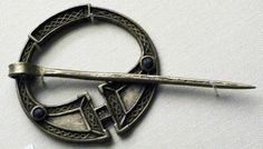 Irish pseudo-penannular brooch in bronze with glass, British Museum - photo by Johnbod