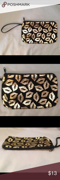 Small Black Cotton-Polyester w/Metallic Gold Lips 55% cotton-45% polyester fabric, soft & sort of feels like felt. Black faux leather strap. Clean inside & outside, appears to have never been used. Can hold cards, cash/change, a smaller phone. Very cute! Bags Clutches & Wristlets