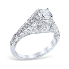 <p>Monica engagement ring showcasing 10 bead set diamonds surrounded by scrolling pierced filigree and leaf-like plates surrounding the center diamond.</p> <p><br />MSRP 14K:  $3,275.00<br />MSRP 18K:  $3,790.00<br />MSRP Plat:  $4,605.00<br /><em>(Not including center diamond)</em></p> <p><br />Center Diamond Carat Range: 0.50-2.00ct.<br />Tota...