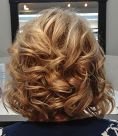 Lob Haircut with soft curls and golden highlights