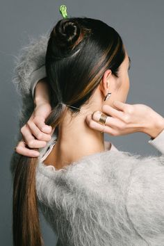 """Work Hair That Will Get You That Promotion   Pull the rest of your hair into a low, tight ponytail at the nape of the neck. """"To make the hair in the ponytail especially tight, tip your head back a little,"""" Reyman advises. """"This will make the nape extra taut, so there won't be any sagging."""""""