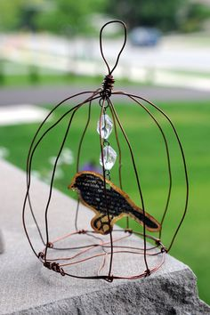 wire cage with paper bird