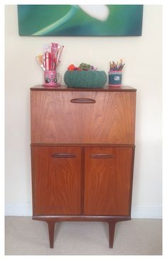 Vintage cocktail cabinet used as yarn storage at Crafts from the Cwtch blog.
