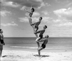 """This photo by amateur photographer George Caddy was taken on Bondi Beach Australia in The people from the local Men's Gymnastic Club are performing the popular entertainment """"Beach-o-batics"""" - gymnastics on the sand. Fitness Workouts, Muscle Beach, Photo Vintage, Partner Yoga, Bondi Beach, Yoga Challenge, Yoga Inspiration, Fitness Inspiration, Vintage Photography"""